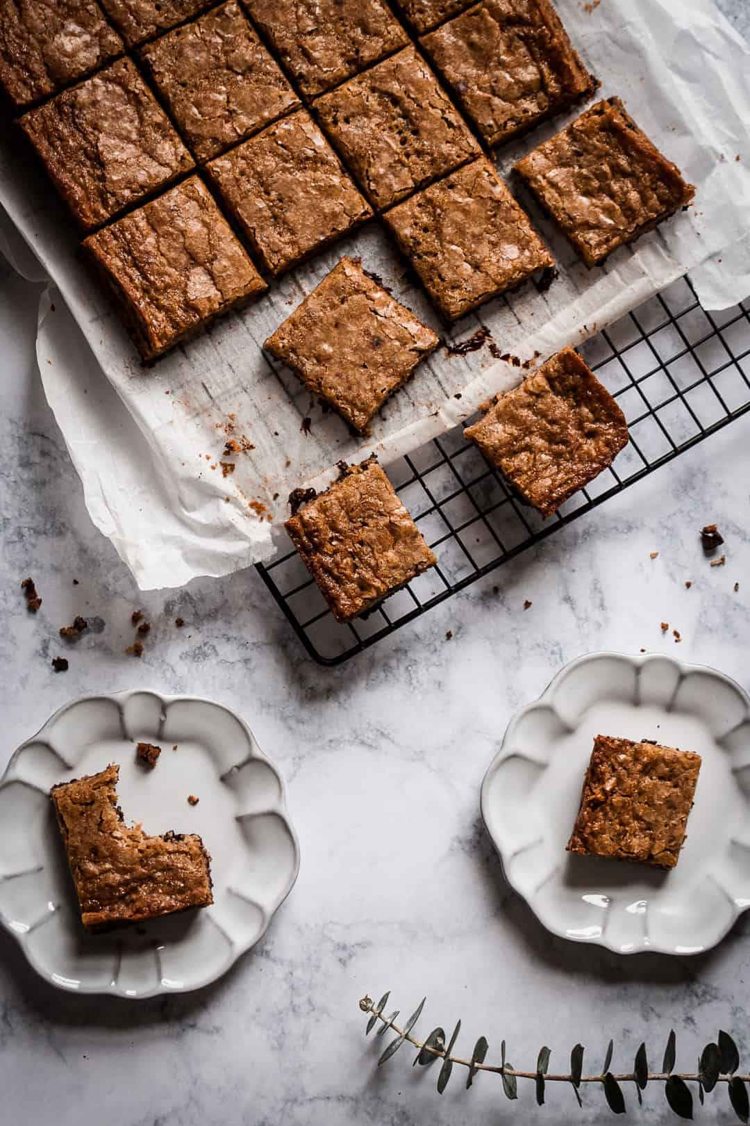 butterscotch dark chocolate bars on a cooling rack on a marble countertop