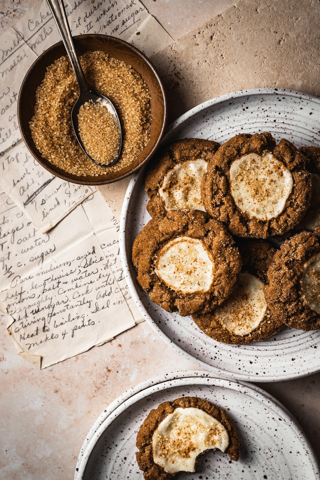 Pumpkin cookies on a plate with recipes in background