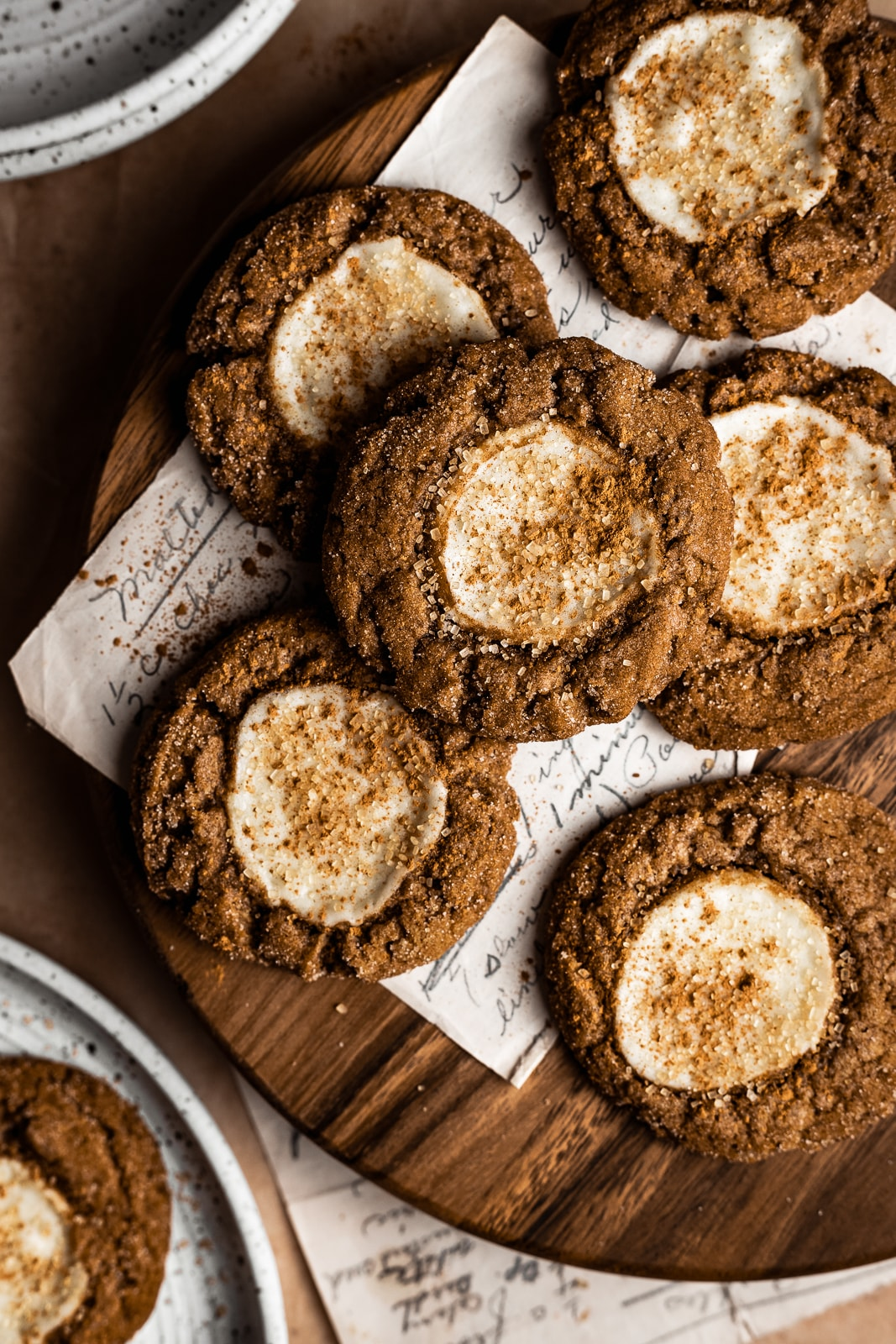 Pumpkin cream cheese cookies on a round wooden board